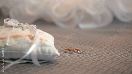 wedding pillow and gold rings