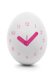 Pink clock dial on white egg isolated on white