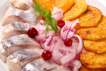 herring with fried potatoes