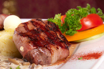 grilled meat with bacon