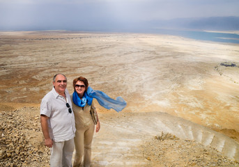 Elderly couple in mountains overlooking Dead Sea