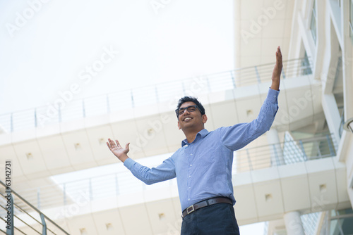 Indian businessman celebrating success at office