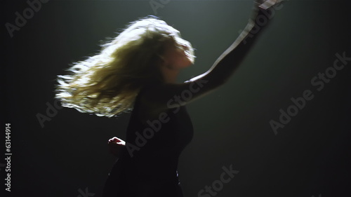 Blond long-haired female performing dance