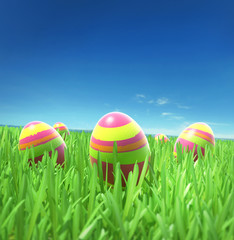 Easter eggs on the grass under sky