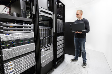It technician monitors data center