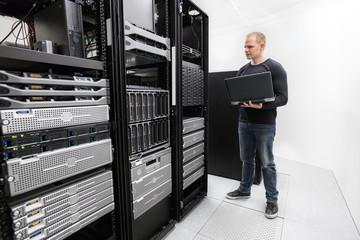 It technician monitors data center