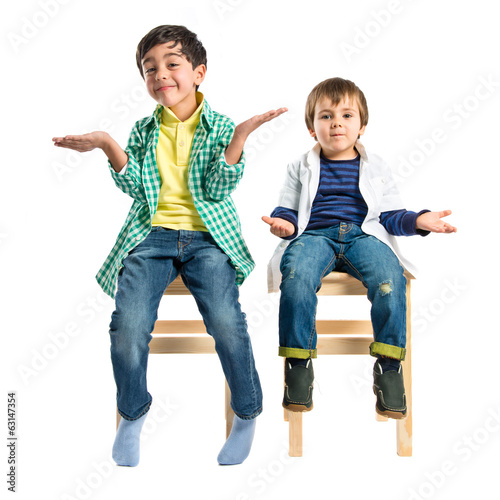 Kids with doubts over white background