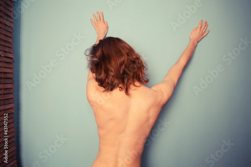 Rear view of slender topless woman