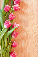 Tulips flowers frame and background wood.
