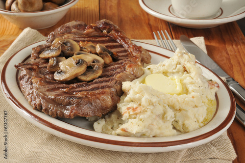 Rib steak and potatoes