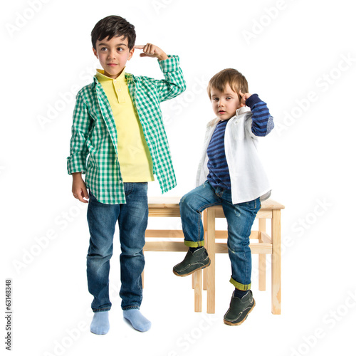 Kids making a crazy gesture over white background