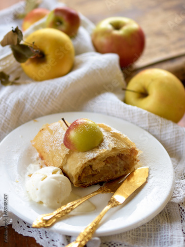 Apple strudel with vanilla ice cream on plate
