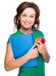 Young student girl is holding book and apple