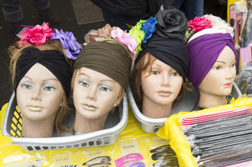 Doll heads with hair decoration on the Albert Cuyp market in Ams
