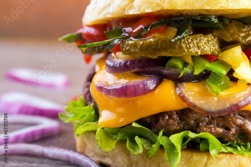 Juicy burger closeup with roasted vegetables
