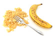 Spotty ripe banana with mashed flesh and fork