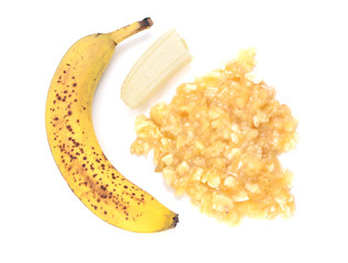 Spotty, overripe banana with whole and mashed fruit