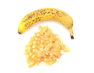 Spotty ripe whole banana with mashed fruit
