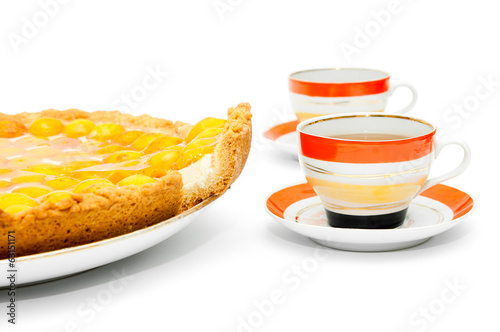 piece of apricot cake and cups of tea