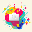 Photo camera on abstract colorful spotted background with differ