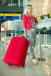 girl with a suitcase at the airport