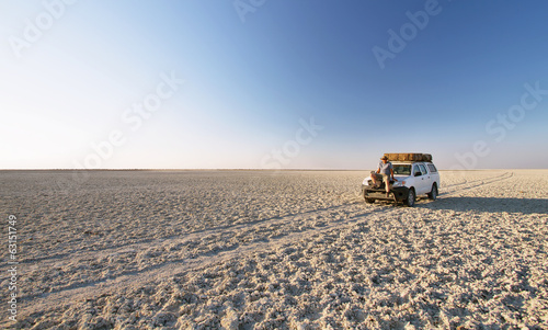 canvas print picture Car in the middle of salt lake near Kubu island