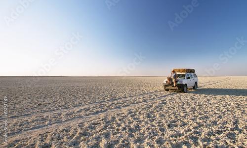 Leinwandbild Motiv Car in the middle of salt lake near Kubu island