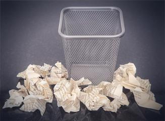 Wastepaper basket with wrinkled paper