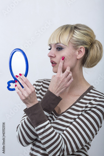 Woman investigates folds in a mirror