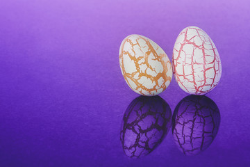 Two easter Eggs with cracks