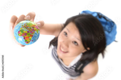 asian chinese traveler woman with backpack looking world globe