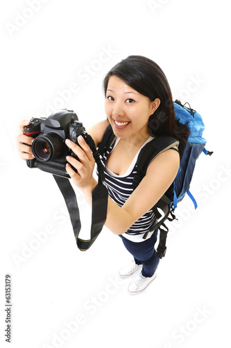 chinese tourist woman with backpack and photo camera