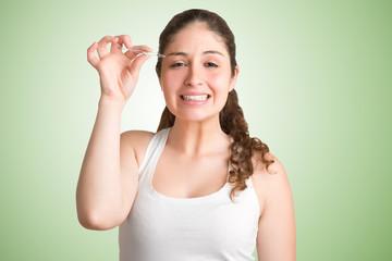 Woman Plucking Eyebrows