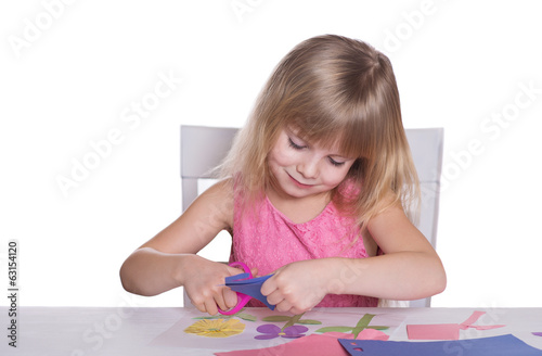 Little girl making a crafts.