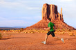 Running man sprinting in Monument Valley