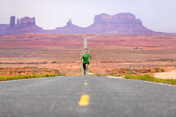 Running man - runner on road by Monument Valley