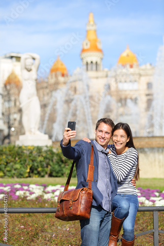 Tourist travel couple taking selfie in Barcelona