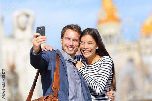 Lovers - young couple happy taking selfie photo