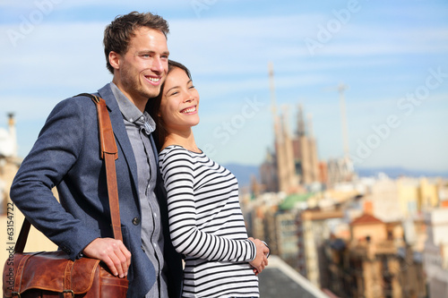 Happy romantic couple looking at view of Barcelona