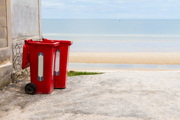 Large red trash can (garbage bin) with wheel