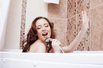 Image of funny young brunette singing in shower