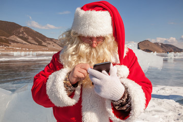 Santa Claus standing outdoors at ice