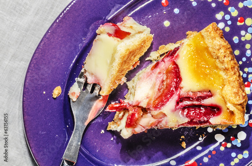 Slice of plum cake on purple plate