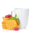 Stack of crackers with mint, berries and cup of drink