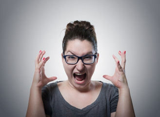 Woman screaming in horror, grimace portrait
