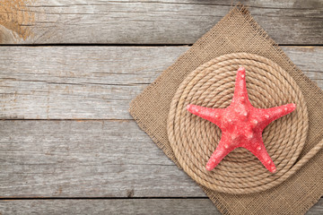 Starfish over ship rope and burlap