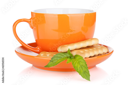Cup of drink with crackers and mint