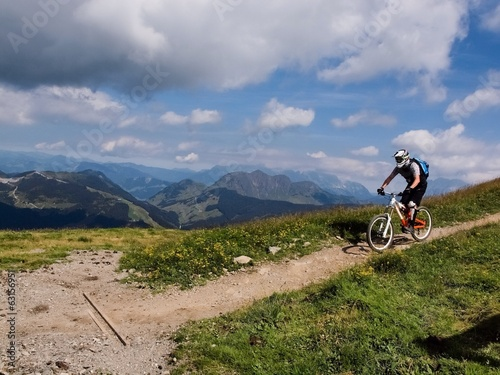 mountain cyclist in front of montain landscape