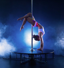 Image of flexible skinny girl dancing on pole