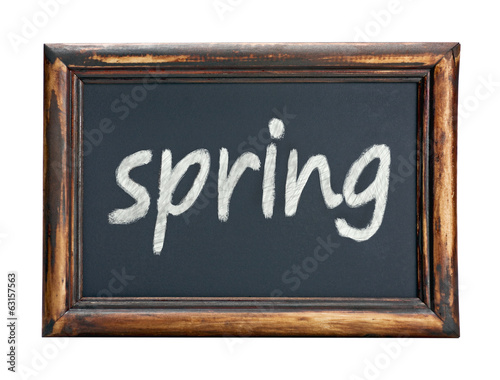 Black chalk board with the word spring